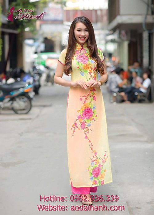 Áo dài vàng voan in hoa cổ truyền thống 1GN tay ngắn